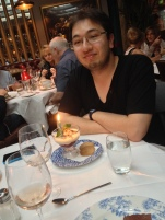 My brother receiving his dessert, with a special birthday candle! Thank you to our waiters for this!